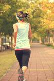 Woman running at park Stock Images