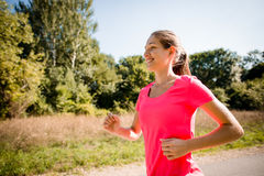 Woman running in park Stock Photo