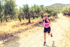 Woman running on path, Crete Island, Greece Stock Photo