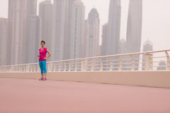 Woman running on the promenade Royalty Free Stock Images