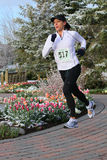 Woman running in race Royalty Free Stock Photos