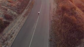 Woman runs at country road. Woman running on the road at the morning stock video