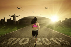 Woman running on the road Stock Photos