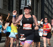 Woman running the 2013 Rock 'n' Roll Chicago Half Marathon Royalty Free Stock Image