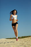 Woman running on sand Stock Image