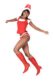 Woman running in Santa costume royalty free stock photography