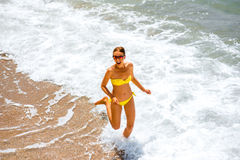 Woman running on the sea coast Stock Photography