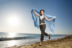Woman running at sea shore Stock Photography