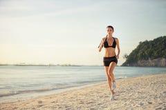 Woman running seaside beach Stock Photos