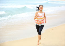 Woman running seaside royalty free stock photography