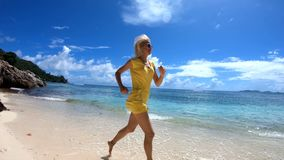Woman running at Seychelles in slow motion stock footage