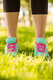 Woman in running shoes standing on grass Royalty Free Stock Photography