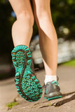 Woman in running shoes stepping on path Royalty Free Stock Images