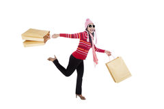 Woman running with shopping bags Royalty Free Stock Photography
