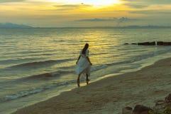 Woman running at shore Royalty Free Stock Photography