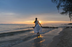 Woman running at shore Royalty Free Stock Photos