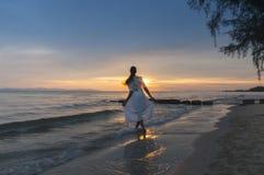 Woman running at shore Royalty Free Stock Photos