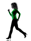 Woman Running silhouette isolated. One mixed race young woman Running silhouette isolated on white background Royalty Free Stock Photos
