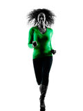 Woman Running silhouette isolated. One mixed race young woman Running silhouette isolated on white background Royalty Free Stock Image