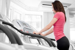 Woman on a running simulator Stock Images
