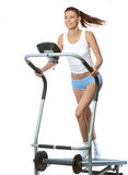 Woman on a running simulator Royalty Free Stock Photo