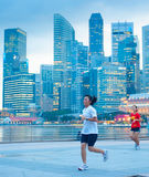 Woman running in Singapore Royalty Free Stock Photos