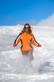 Woman running on the snow Stock Photography