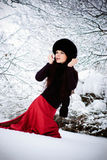 Woman running on snow. Pretty woman running on snow and turns around Stock Images