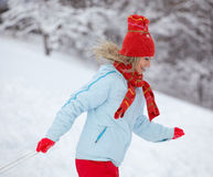Woman running through the snow Stock Photography