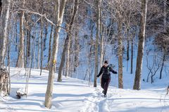 Woman running in the snow Stock Image