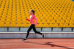 Woman running at the stadium Royalty Free Stock Photo