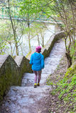 The woman running the stairs in the Park. Stock Photography