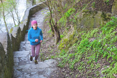 The woman running the stairs in the Park. Royalty Free Stock Photos