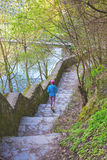 The woman running the stairs in the Park. Royalty Free Stock Photography
