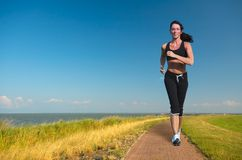 Woman running in summer stock photography