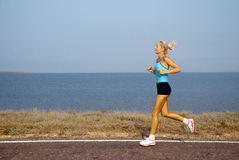 Woman running on a summer day Stock Photography