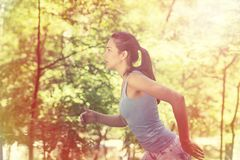 Woman running in summer forest Royalty Free Stock Photo