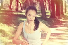 Woman running in summer forest Royalty Free Stock Images