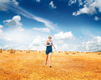 Woman Running Through Summer Harvested Field Stock Images