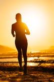 Woman running and sun Stock Photos