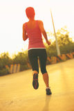 Woman running sunrise mountain road Royalty Free Stock Images