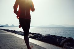woman running on sunrise seaside Royalty Free Stock Images