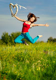 Woman running on a sunset field Royalty Free Stock Photo