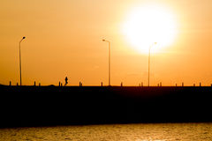 Woman is running in sunset (silhouette) royalty free stock photos