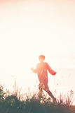 Woman Running to Freedom Through Countryside Field Royalty Free Stock Photography