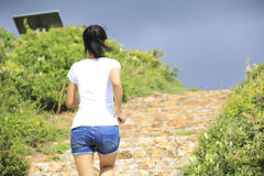 Woman running to heaven. Young asian woman running to mountain top Stock Photography