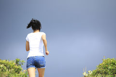 Woman running to heaven Stock Photography