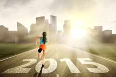 Woman running towards the future stock photography