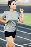 Woman running on track Royalty Free Stock Photos