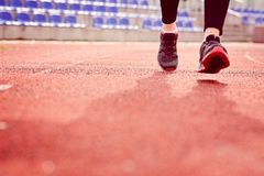 Woman running on the track Stock Images